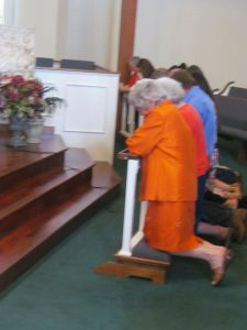 A member of Faith United Methodist Church praying at the alter